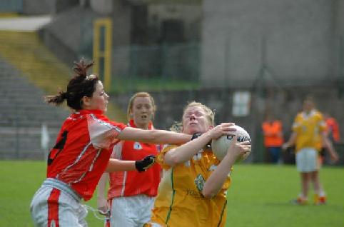 Mairead Cooper holds off an Armagh attack