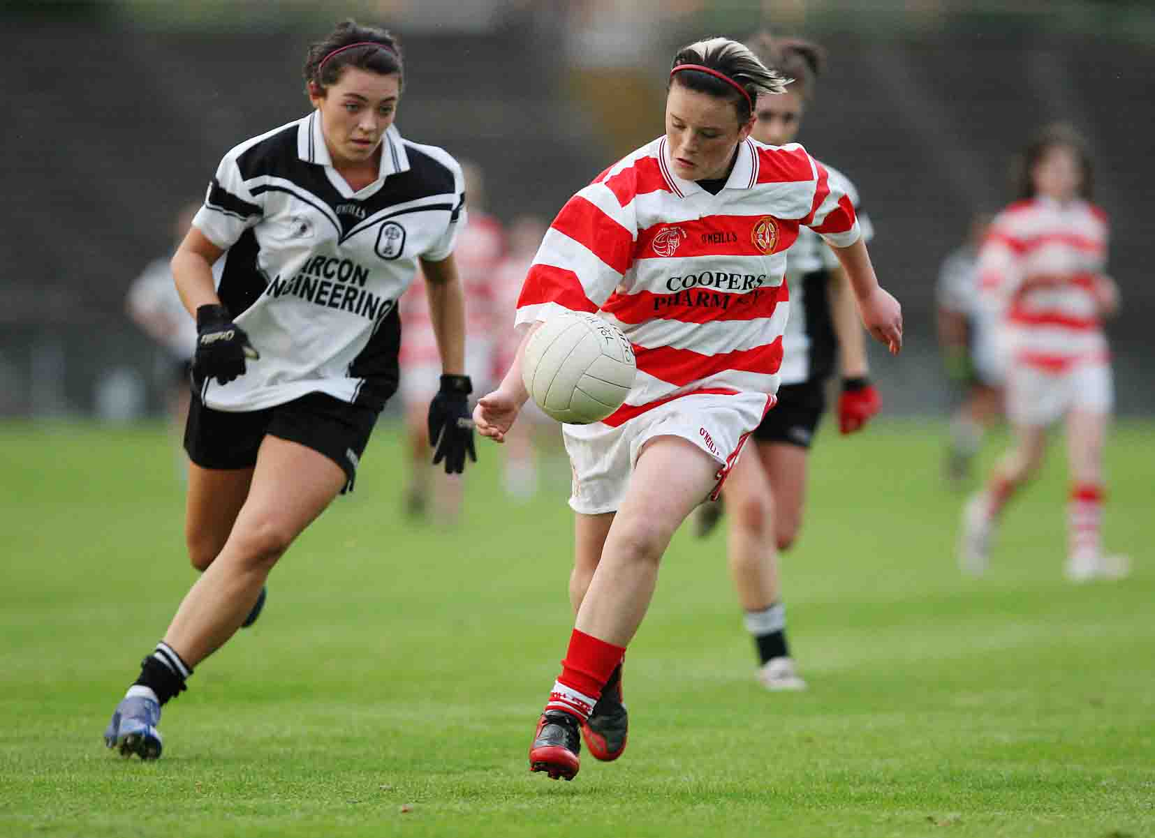St Paul's Ursula Mc Cotter gets clear of All Saints Laura Mc Nicholl and goes for goal